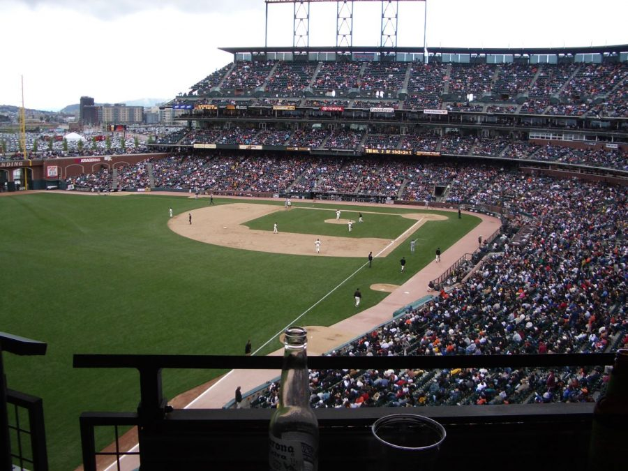 A ballpark loaded with fans ready to watch a baseball game from a few year ago