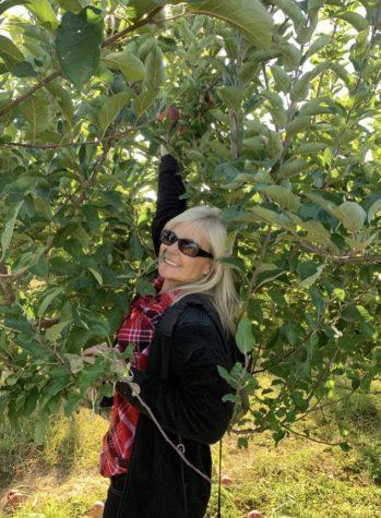 Mrs. Wilson apple picking to make apple pie!