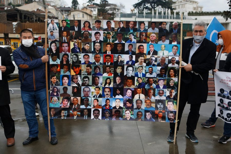 Members+in+the+Uighur+community+during+a+protest+displayed+pictures+of+family+and+friends+who+they+fear+may+be+in+the+camps.